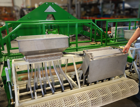 Sutton Seeder tiltable seed hoppers